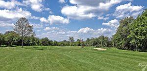 Budowa pola golfowego w Kamieniu Śląskim / galeria pól golfowych - pielęgnacja i koszenie trawy na green dołka 12 podczas budowy.