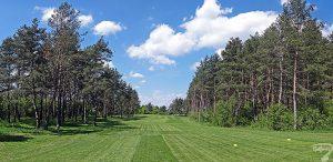 Budowa pola golfowego w Kamieniu Śląskim / galeria pól golfowych - pielęgnacja i koszenie trawy na dołku 17 podczas budowy.